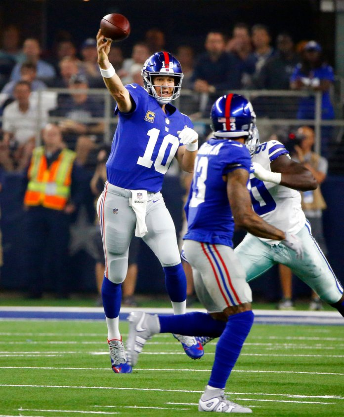 New York Giants quarterback Eli Manning (10) throws against the Dallas Cowboys during the first half of an NFL football game in Arlington, Texas, Sunday, Sept. 16, 2018. (AP Photo/Michael Ainsworth)
