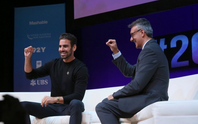 Rajesh Mirchandani, United Nations Foundation Chief Communications Officer, right, and model, actor and deaf activist Nyle DiMarco, left, close out the day with a lesson in sign language at the Social Good Summit in New York on Sunday, September 23. The Social Good Summit explores how technology and new media can be leveraged to address global issues. (Photo by Stuart Ramson/Invision for United Nations Foundation/AP Images)