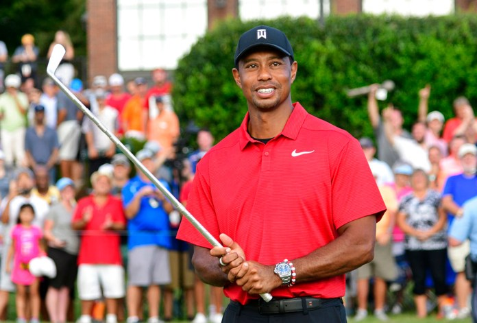 Tiger Woods holds Calamity Jane, the official trophy of the tournament, after winning the Tour Championship golf tournament Sunday, Sept. 23, 2018, in Atlanta. (AP Photo/John Amis)