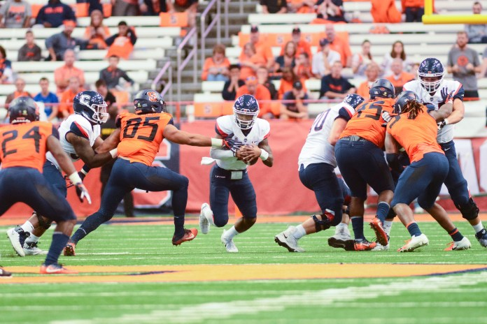 The UConn Huskies lost to Syracuse 51-21 this Saturday in the Carrier Dome. David Pindell (5) lead the team once again with 151 passing yards and 113 rushing yards. Their next home game is on 9/29 against Cincinnati (Eric Wang/The Daily Campus)