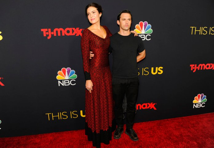 """Mandy Moore, left, and Milo Ventimiglia arrive at a season three premiere screening of """"This Is Us"""" on Tuesday, Sept. 25, 2018, at Paramount Studios in Los Angeles. (Photo by Chris Pizzello/Invision/AP)"""