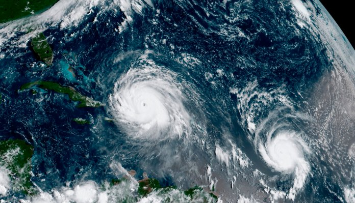 FILE - This Thursday, Sept. 7, 2017 satellite image made available by NOAA shows the eye of Hurricane Irma, left, just north of the island of Hispaniola, with Hurricane Jose, right, in the Atlantic Ocean. Six major hurricanes _ with winds of at least 111 mph (178 kph) _ spun around the Atlantic in 2017, including Harvey, Irma and Maria which hit parts of the United States and the Caribbean. (NOAA via AP)