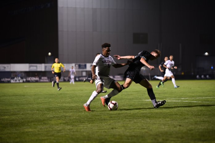 The Men's Soccer team defeat Loyola 3-2 in a short noticed home game on September 15. THe game went in double overtime and Abdou Mack Thiam scores the winning goal. (Photo by Charlotte Lao/The Daily Campus)