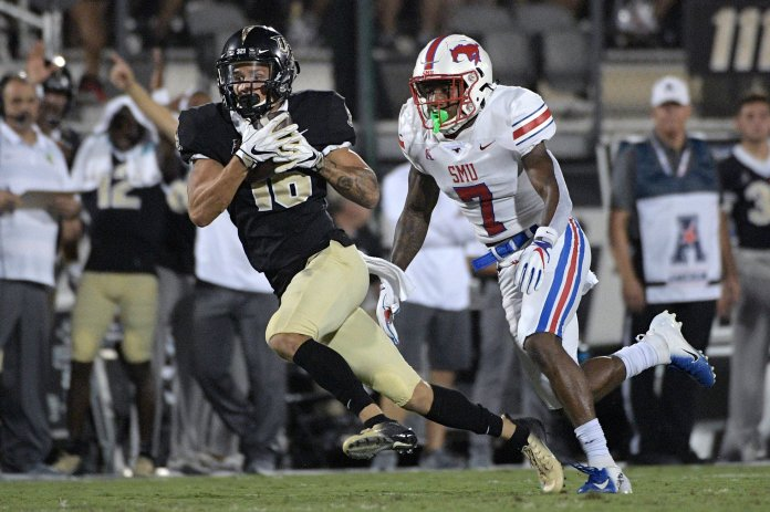 Central Florida wide receiver Tre Nixon (16) catches a pass in front of SMU cornerback Robert Hayes Jr. (7) for a gain during a game on Saturday, Oct. 6 in Orlando, Florida. (Phelan M. Ebenhack/AP)