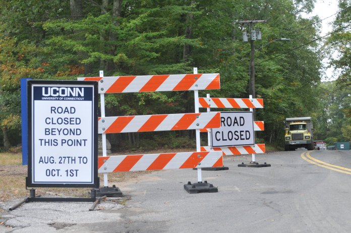 Construction on Jim Calhoun Way continues to disrupt access to the road. Pedestrian access to the area is possible via the Hilltop Apartments, but the road remains closed to passenger vehicles long after the posted time interval has ended. (Sachin Menon/The Daily Campus)