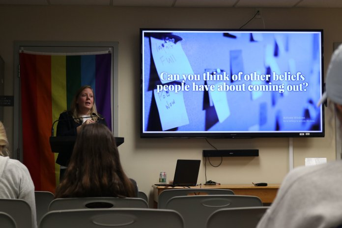 """Julia Anderson presents on misconceptions and issues surrounding the process of """"coming out"""" in the LGBTQI community in the Rainbow Center. The Out to Lunch lecture fell on National Coming Out day, October 11th. (Photo by Maggie Chafouleas/The Daily Campus)"""