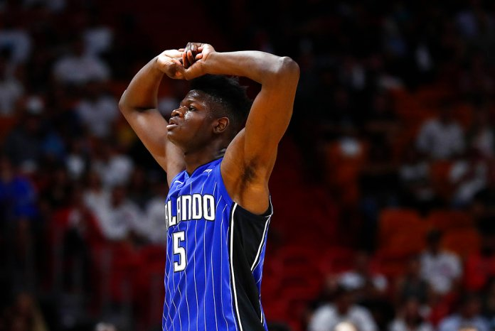 Orlando Magic center Mohamed Bamba reacts during the fourth quarter of a preseason NBA basketball game against the Miami Heat in Miami, Monday, Oct. 8, 2018. (AP Photo/Brynn Anderson)