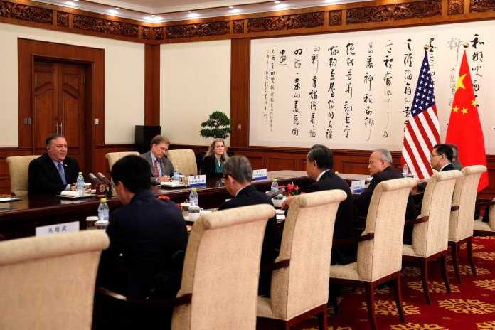U.S. Secretary of State Mike Pompeo, left, meets with Chinese Foreign Minister Wang Yi, third from left in front, at the Diaoyutai State Guesthouse in Beijing, Monday, Oct. 8, 2018. (AP Photo/Andy Wong, Pool)