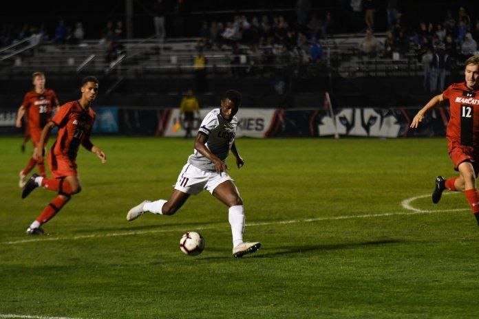 Abdou Mbacke Thiam attacks the Cincinnati defense during a game on Oct. 6, 2018. (Nicholas Hampton/ The Daily Campus)