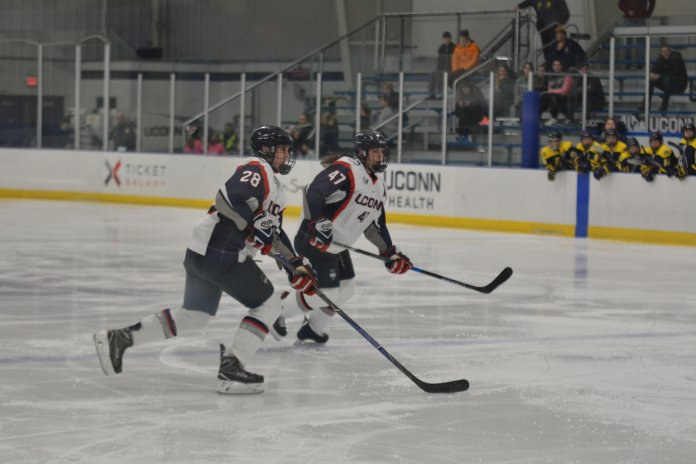 Kayla Mee and Jamie Fox enter the offensive zone during a game against Merrimack on Oct. 28, 2018. (The Daily Campus)