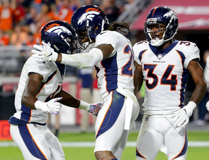 Bradley Roby celebrates his touchdown against the Arizona Cardinals with cornerback Isaac Yiado, left, and defensive back Will Parks. (AP Photo/Rick Scuteri)