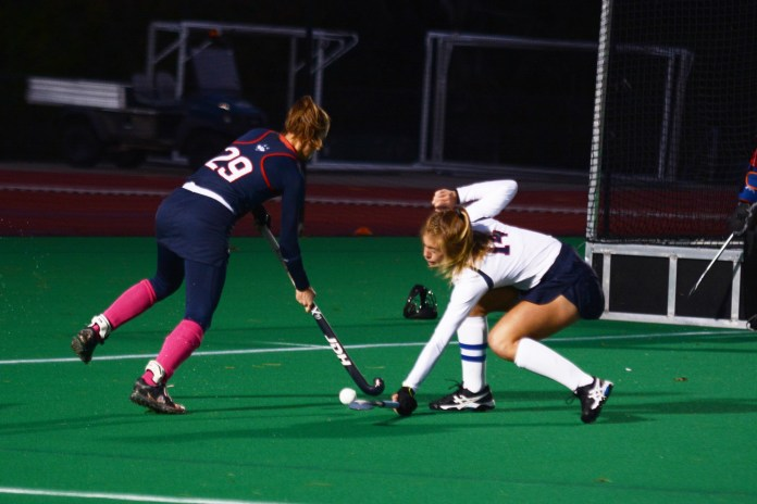 The UConn Huskies Women's Field Hockey Team compete against the Liberty Flames for the Big East conference 2018 title at the Sherman Family Sports Complex on October 18, 2018. The Huskies scored the championship win with an end score of 6-1 (Judah Shingleton/The Daily Campus)
