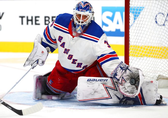 New York Rangers goalie Henrik Lundqvist makes a save in overtime during an NHL hockey game against the San Jose Sharks Tuesday, Oct. 30, 2018, in San Jose, Calif. (AP Photo/Ben Margot)
