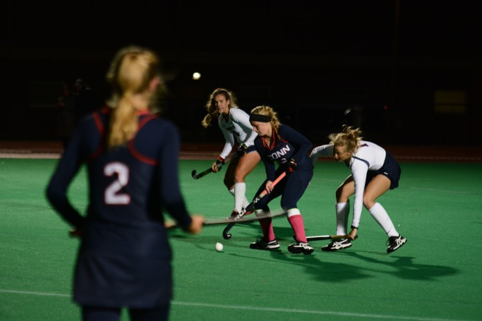 The UConn Huskies Women's Field Hockey Team compete against the Liberty Flames for the Big East conference 2018 title at the Sherman Family Sports Complex on October 18, 2018. The Huskies scored the championship win with an end score of 6-1.