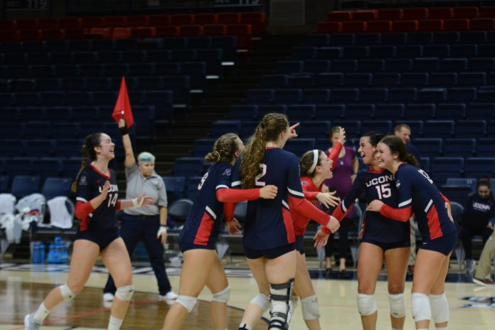 UConn Volleyball celebrates during a match against UCF on Nov. 4, 2018. (Judah Shingleton/ The Daily Campus)