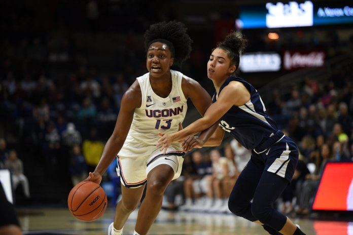 Christyn Williams drives past a Vanguard defender during the Huskies' 96-30 victory on Nov. 4, 2018. (Charlotte Lao/ The Daily Campus)