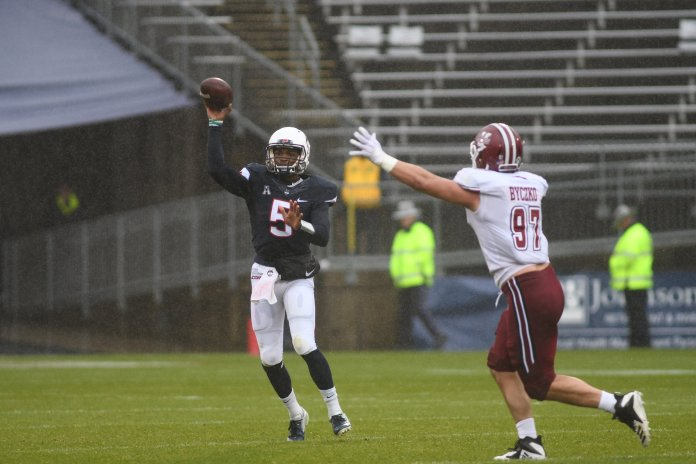 UConn quarterback David Pindell drops back to pass during a game against UMass on Oct. 27, 2018. (Charlotte Lao/ The Daily Campus)