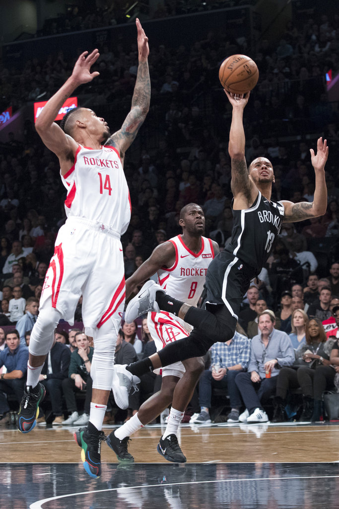 Brooklyn Nets guard Shabazz Napier (13) is fouled by Houston Rockets guard Gerald Green (14) during the second half of an NBA basketball game, Friday, Nov. 2, 2018, in New York. (AP Photo/Mary Altaffer)