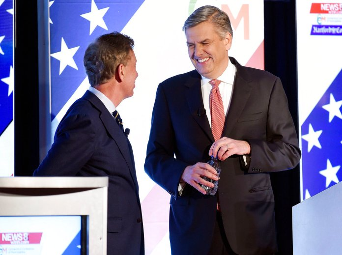 Two of the three leading candidates for Connecticut Governor; Democrat Ned Lamont, left, and Republican Bob Stefanowski, right, chat prior to facing off in their final gubernatorial debate with and petitioning candidate Oz Griebel one week before the election Tuesday, Oct. 30, 2018 at at the Premier Ballroom at Foxwoods in Ledyard, Conn. (Sean D. Elliot/The Day via AP)
