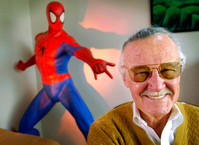 """In this April 16, 2002, file photo, Stan Lee, 79, creator of comic-book franchises such as """"Spider-Man,"""" """"The Incredible Hulk"""" and """"X-Men,"""" smiles during a photo session in his office in Santa Monica, Calif. Comic book genius Lee, the architect of the contemporary comic book, has died. He was 95. (AP Photo/Reed Saxon, File)"""