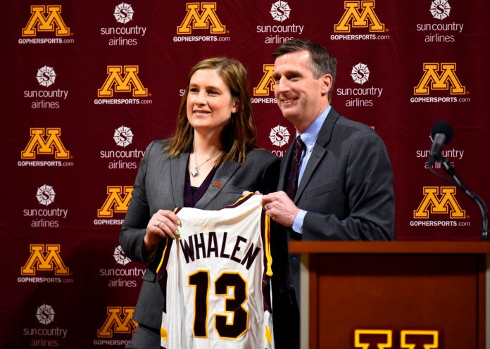FILE - In this April 13, 2018, file photo, Lindsay Whalen, Minnesota new women's basketball coach, holds up a team jersey alongside athletic director Mark Coyle during an NCAA college basketball news conference at Williams Arena in Minneapolis. The Minnesota women's basketball team has sold out the home opener, a clear sign of the buzz surrounding the program following the hire of the beloved Lindsay Whalen as head coach. (Aaron Lavinsky/Star Tribune via AP, File)
