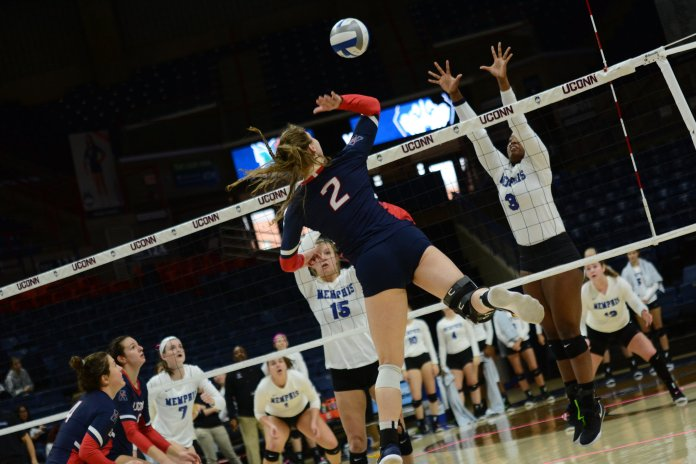 UConn's Danielle Cabel goes vertical during a game against Memphis on Oct. 21, 2018. (Judah Shingleton/ The Daily Campus)