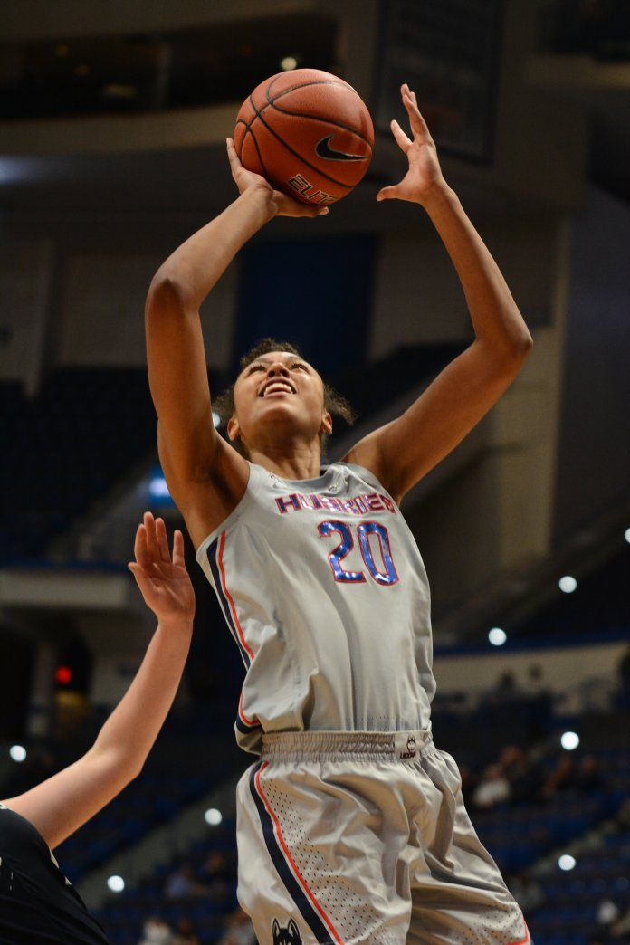 Olivia Nelson-Ododa takes the ball to the hole. (Eric Wang/ The Daily Campus)