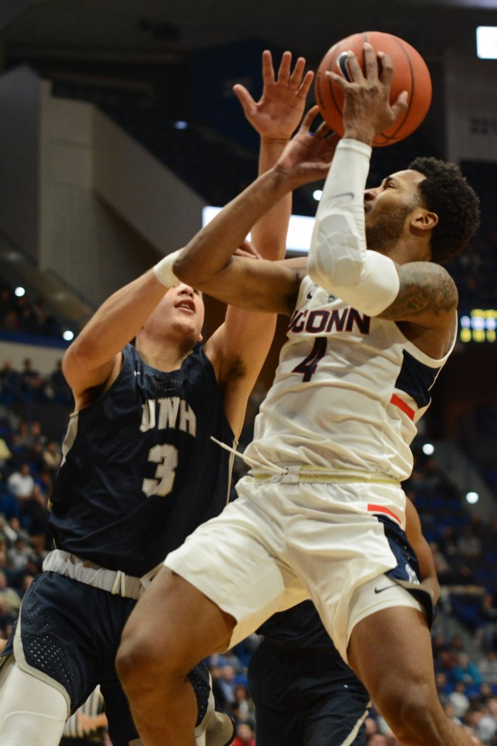Jalen Adams rises up and draws contact against New Hampshire's Nick Guadarrama in Saturday's win. (Eric Wang/The Daily Campus)