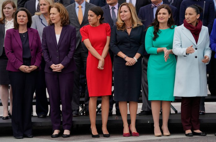 Angie Craig, Kim Schrier, Alexandria Ocasio-Cortez, Debbie Mucarsel-Powell, Abby Finkenauer, and Sharice Davids line up as they join other members of the freshman class of Congress for a group photo on Capitol Hill in Washington on Wednesday, Nov. 14. (Pablo Martinez Monsivais/AP)