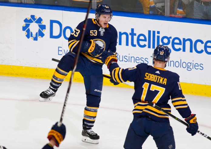 Buffalo Sabres forward Jeff Skinner (53) celebrates his game-winning goal following the overtime period against the San Jose Sharks, in Buffalo N.Y. (AP Photo/Jeffrey T. Barnes)