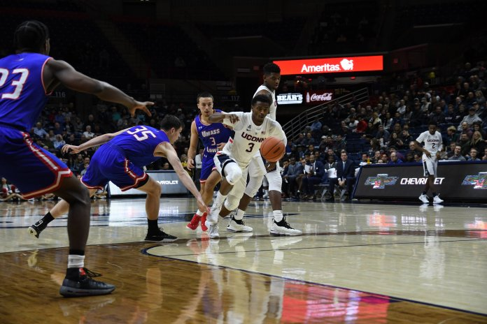 Alterique Gilbert slashes to the rim during the Huskies 97-75 win over UMass-Lowell on Nov. 27, 2018. (Nicholas Hampton/ The Daily Campus)