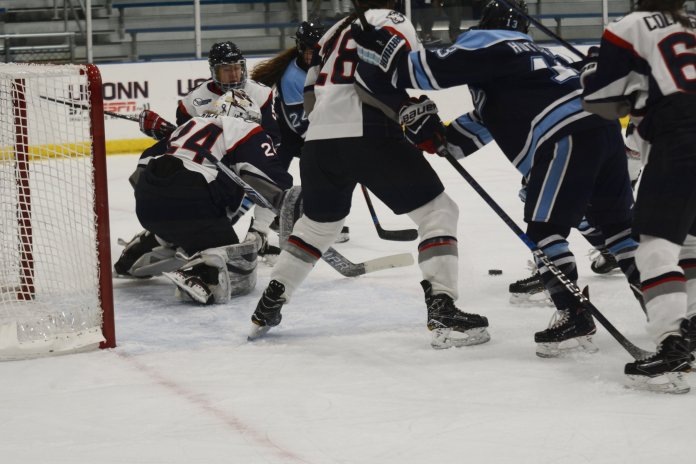 Goalie Morgan Fisher protects the UConn goal during a game against Maine on Saturday, Nov. 10 at the Freitas Ice Forum. (Eric Wang, Staff Photographer/The Daily Campus)