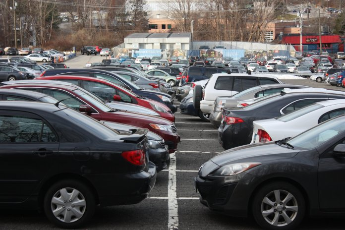 A full lot of cars in the X parking lot on the North side of UConn's Storrs campus on December 5, 2018. Students are questioning the legality of advertisements being placed on cars in UConn parking lots. (Photo by Judah Shingleton/The Daily Campus)