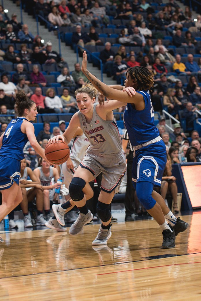 Katie Lou Samuelson drives to the basket during their 99-61 win over Seton Hall. (Charlotte Lao/ The Daily Campus)