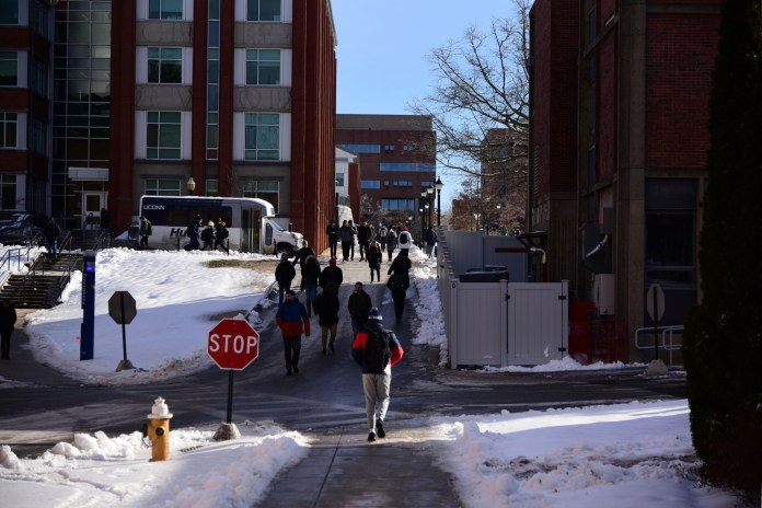 Students around campus walking around, doing their best to not to slip and fall (Kush Kumar/The Daily Campus)
