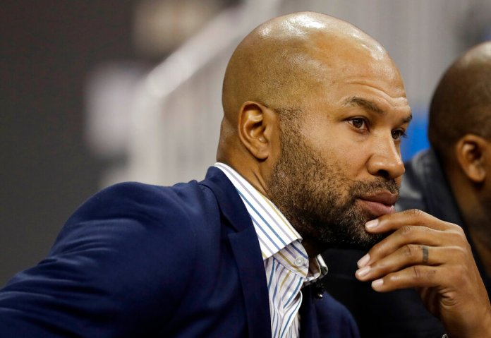 Derek Fisher, head coach of the WNBA Los Angeles Sparks, watches an NCAA college basketball game between UCLA and Oregon Sunday, Jan. 13, 2019, in Los Angeles. (AP Photo/Marcio Jose Sanchez)