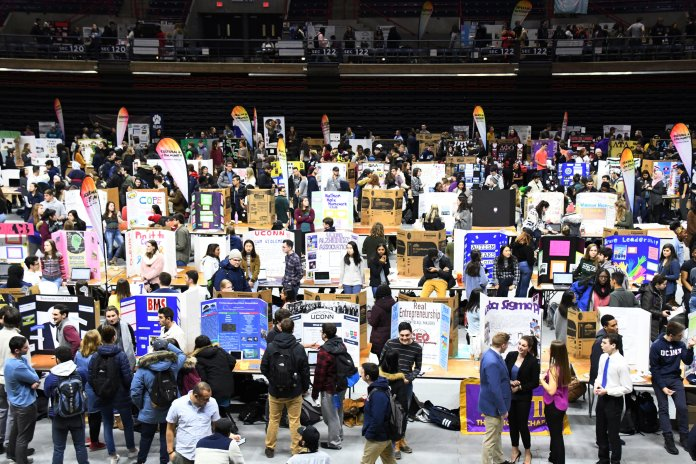 The spring semester Involvement Fair was held on Jan. 30 in Gampel Pavilion and drew quite the crowd from clubs and potential members alike. (Julie Spillane/The Daily Campus)