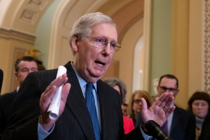 Senate Majority Leader Mitch McConnell, R-Ky., speaks to reporters asking about the threat of another government shutdown following their weekly strategy meeting, at the Capitol in Washington, Tuesday, Jan. 29, 2019. With the government funded for three weeks, it's up to a group of House and Senate negotiators to avoid another closure. (AP Photo/J. Scott Applewhite)