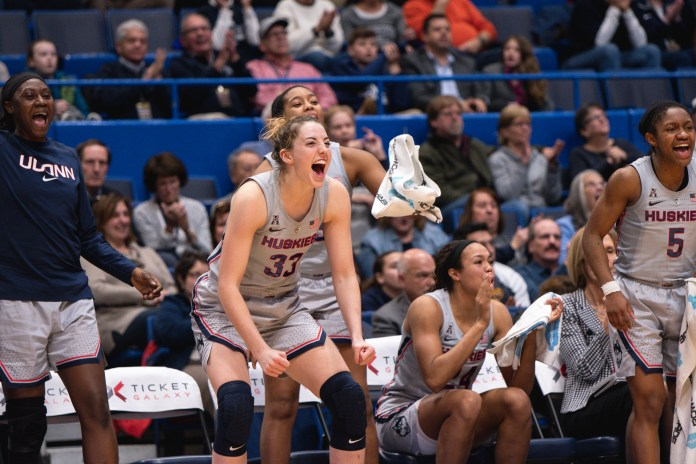 Katie Lou Samuelson celebrates on the bench during UConn's rout of ECU (Charlotte Lao/The Daily Campus)