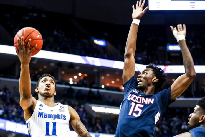 Memphis' Antwann Jones Jr., left, goes up for a shot against UConn's Sidney Wilson, right, during an NCAA college basketball game Sunday, Feb. 10, 2019, in Memphis, Tenn. (Brad Vest/The Commercial Appeal via AP)