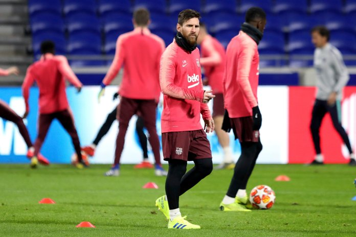 FC Barcelona's Lionel Messi, center, plays with the ball with his teammates during a training session in Decines, near Lyon, central France, Monday, Feb. 18, 2019. FC Barcelona will face Lyon in a Champions League round of 16 soccer match on Tuesday. (AP Photo/Laurent Cipriani)