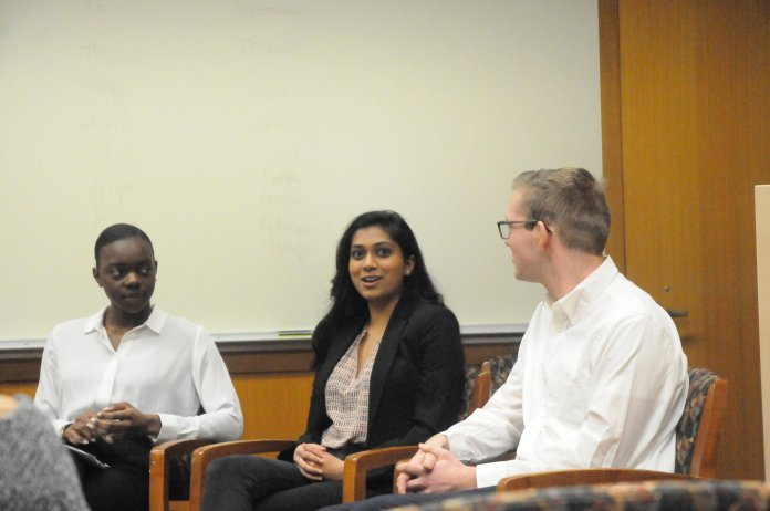"""A panel of student leaders from the University of Connecticut Global Health Symposium Organizing Committee (GloHSOC) in the Class of 1947 Meeting Room of the Homer Babbidge Library set a personalized tone at the global health event titled """"Directing the Dialogue: How Global Health Literacy Builds Better Advocates, Activists and Leaders"""" Friday. (Nicole Jain/The Daily Campus)"""