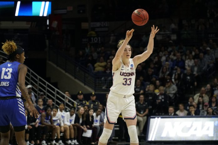 Katie Lou Samuelson sends a pass from the top of the key in the Huskies' second-round win over Buffalo. (Eric Wang/The Daily Campus)