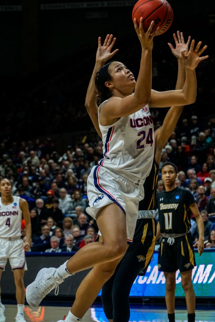 Napheesa Collier rises up for a lay-up in the first-round win over Towson. (Eric Wang/The Daily Campus)