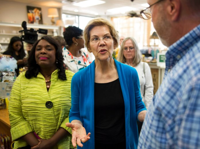 Democratic presidential candidate Sen. Elizabeth Warren, D-Mass., center, talks with owner Tim Williamson at Cater's Drug Store in Selma, Ala., on Tuesday, March 19, 2019. (Jake Crandall/The Montgomery Advertiser via AP)