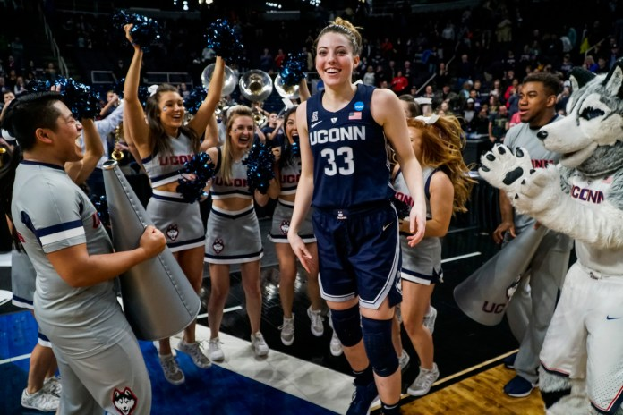 Katie Lou Samuelson celebrates with the UConn cheer team after the big win (Eric Wang/The Daily Campus).