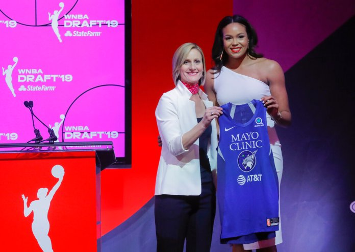 Connecticut's Napheesa Collier, right, poses for a photo with WNBA COO Christy Hedgpeth after being selected by the Minnesota Lynx as the sixth overall pick in the WNBA basketball draft, Wednesday, April 10, 2019, in New York. (AP Photo/Julie Jacobson)