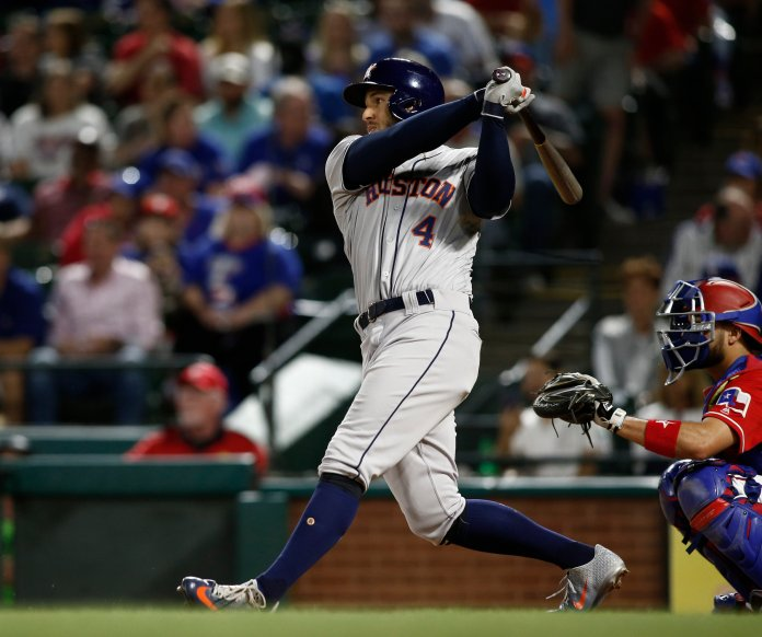 Houston Astros' George Springer(4) hits a two-run home run against the Texas Rangers during the seventh inning of a baseball game Saturday, April 20, 2019, in Arlington, Texas. (AP Photo/Mike Stone)