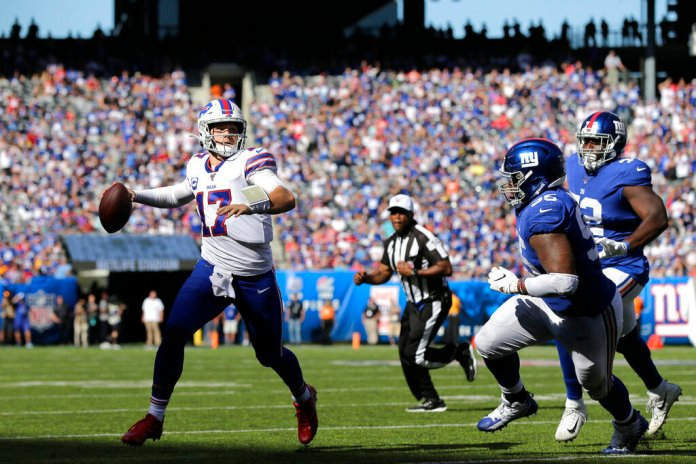 Buffalo Bills quarterback Josh Allen, left, looks to throw during the second half of an NFL football game against the New York Giants.   Photo by Adam Hunger/AP