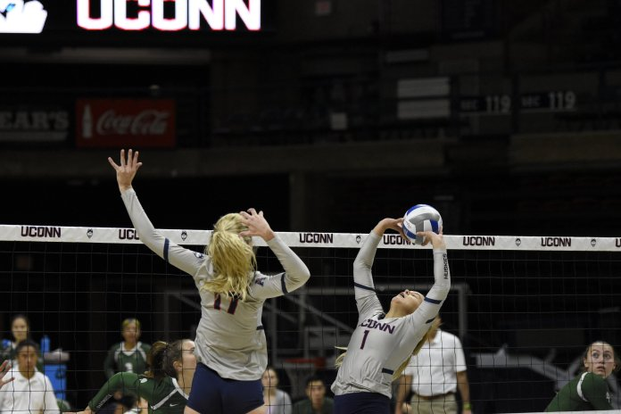 The UConn women's volleyball team play during the Dog Pound Challenge. The team claimed victory in all three games they played.  Photos by Brandon Barzola / The Daily Campus.